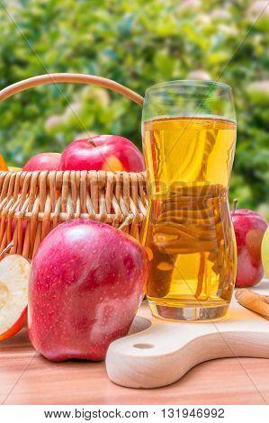 Cider - Hot Apple Beverage On Wooden Table In Garden.