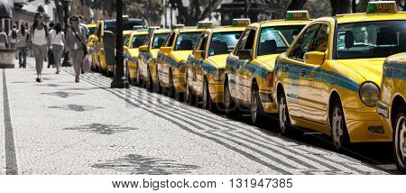 FUNCHAL, MADEIRA -  JUNE 15, 2011: Taxis line up awaiting customers on the street of Funchal