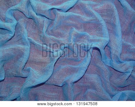 transparent blue fabric on a red background , made of cotton,