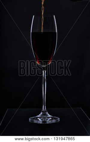 Glass with a long leg on a black background