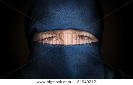 Eyes Of Young Woman Veiled With Blue Niqab Scarf. Low Key Photo.