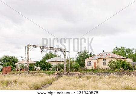 Three houses next to the railroad in Wolwefontein a small village between Kirkwood and Jansenville in the Eastern Cape Province of South Africa