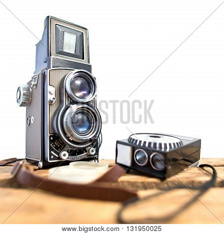 old twin-lens reflex camera with light meter on the white background