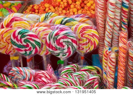 Colorful bonbon lollipops and candy as background