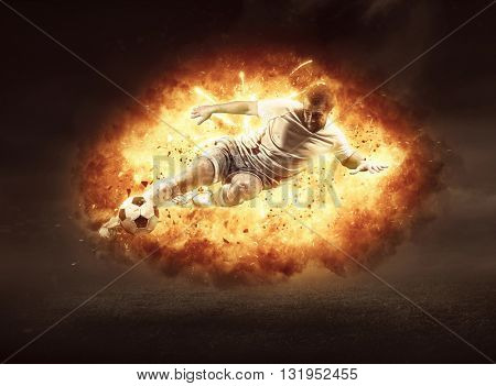 Football player in fire flame on the outdoor field