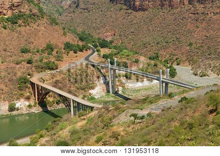 BAHIR DAR, ETHIOPIA - JANUARY 20, 2010: View to the old and new bridge across mountain river in Bahir Dar, Ethiopia.