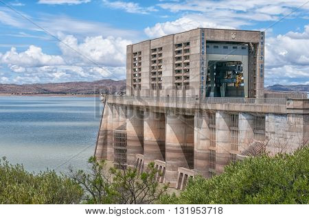 The wall of the Gariep Dam on the border between the Free State and Northern Cape provinces. It is the largest dam in South Africa. The dam is half full