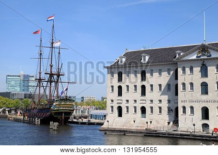 AMSTERDAM, NETHERLANDS - MAY 6, 2016: National Maritime Museum and Dutch sailing cargo ship of 17th century, Amsterdam, Netherlands