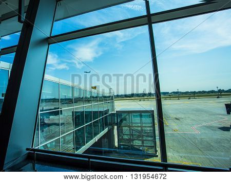 Kiev, Ukraine passenger jet plane flying over airport runway against beautiful dusky sky use for aircraft transport and cargo logistic and traveling business industry. window viev