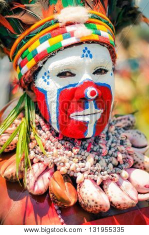 Woman In Mask In Papua New Guinea