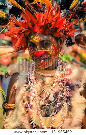 Woman With Smile And Feathers In Papua New Guinea