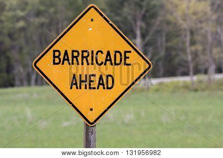 Yellow Barricade Ahead Sign worn with weather