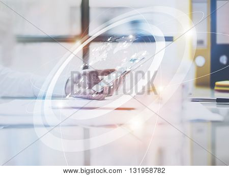 Photo business woman wearing white shirt, touching screen modern smartphone.Open space loft office.Panoramic windows background.Connections world wide interfaces.Horizontal, flares.Film effect