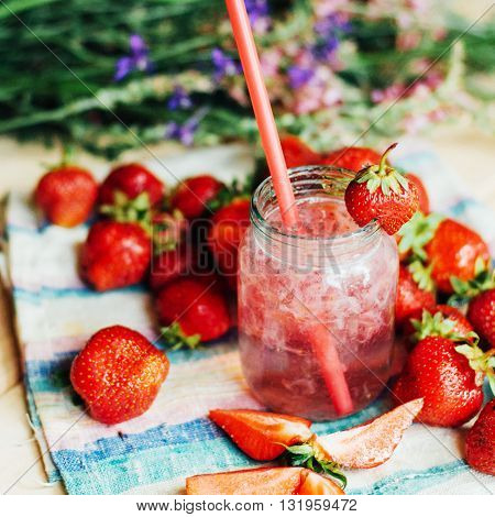A Glass Of Strawberry Smoothie On A Wooden Background. Strawberr