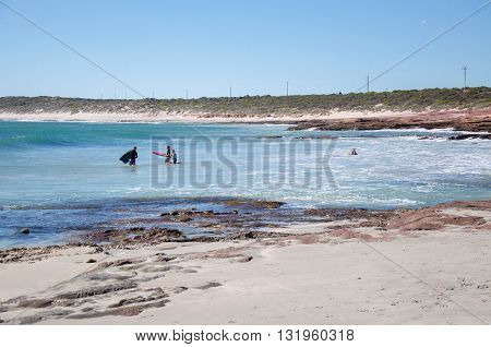 KALBARRI,WA,AUSTRALIA-APRIL 20, 2016: Families body boarding in the turquoise Indian Ocean waves in the bay at the Jake's Point in Kalbarri, Western Australia.