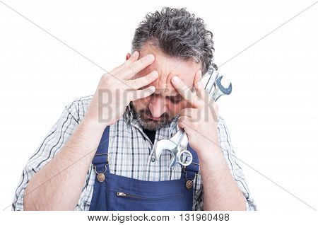 Closeup Portrait Of Young Mechanic Under Pressure Having Head Ache