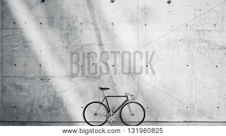 Horizontal Photo Blank Grungy Smooth Bare Concrete Wall in Modern Open Space Studio with Classic bicycle. Soft Sunrays Reflecting on Surface. Empty Abstract background
