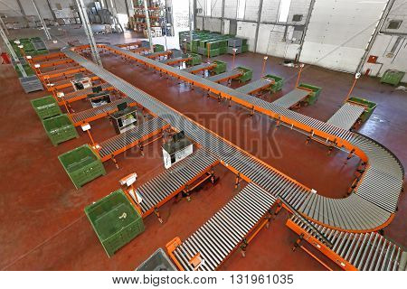 Sorting System With Conveyor Belt in Distribution Warehouse