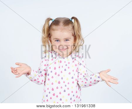 Little girl arms out surprise. Emotions child.