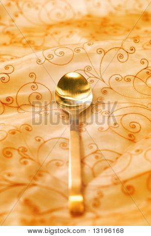 Royal luxury golden spoon (shallow DoF)