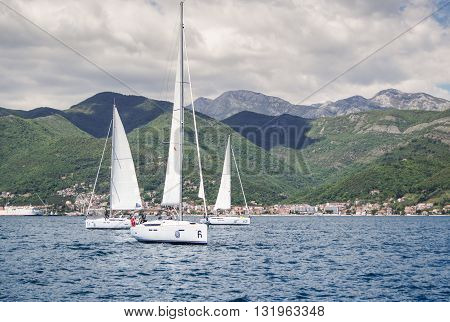 Tivat, Montenegro - 26 April, Three boats on the background of the coast, 26 April, 2016. Regatta