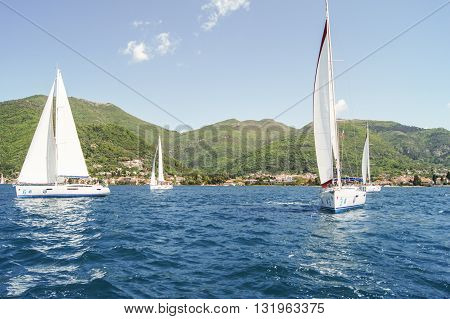 Tivat, Montenegro - 26 April, Yachts on the background of green mountains, 26 April, 2016. Regatta