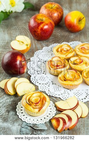Puff apple shaped roses. Homemade apple cake. Sweet cupcake. Gourmet cupcakes. Sweet dessert. Sweet pastry. Homemade dessert. Homemade pastry. Apple dessert. Apple pastry.