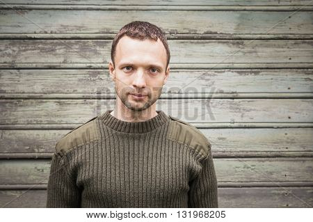 Young Handsome Man In Military Green Sweater