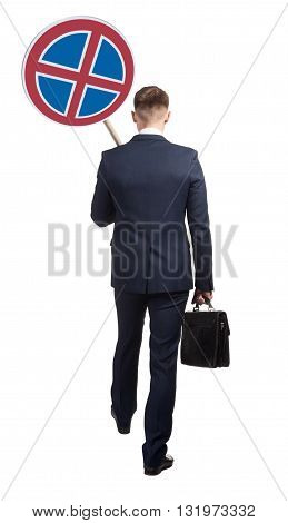 Official man carries a road sign, which means that stop is forbidden. Isolated on white background.