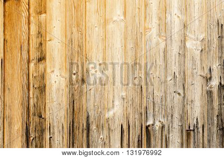 Old planked wood used as background. Wood panelling. Single planks are nailed to one surface. Photo.