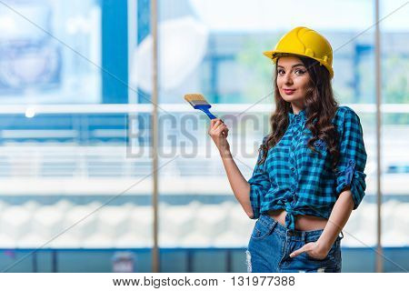 Nice young woman painer working