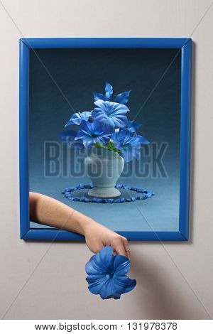 representation of a table with flowers background stone and frame in blue and a hand coming out of the same by giving a flower
