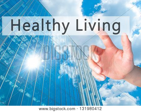Healthy Living - Hand Pressing A Button On Blurred Background Concept On Visual Screen.