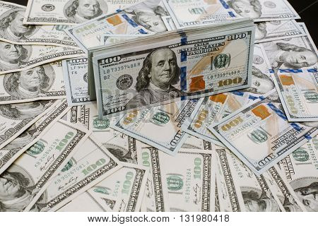 Close-up portrait photo of money. 100 dollars banknotes heap
