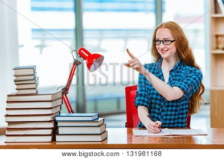 Young female student preparing for exams
