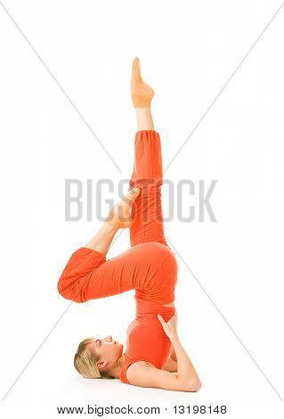 Beautiful young woman doing supported shoulderstand isolated on white background