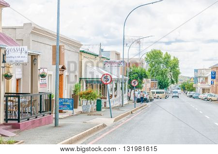 COLESBERG SOUTH AFRICA - MARCH 8 2016: A street scene in Colesberg Northern Cape Province of South Africa. Several businesses are visible