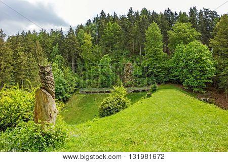 Wental valley reservoir dam - forest / trees in background carved owl in foreground - Swabian Alps (Schwaebische Alb)