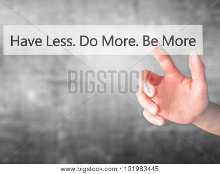 Have Less. Do More. Be More  - Hand Pressing A Button On Blurred Background Concept On Visual Screen