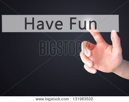 Have Fun - Hand Pressing A Button On Blurred Background Concept On Visual Screen.