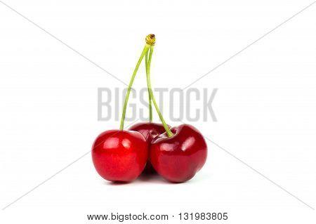 Sweet fresh cherry isolated on white .