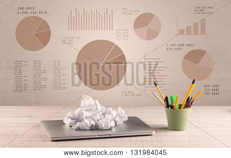 Graphic business office desk with pie charts and graphs on the brown sepia background wall