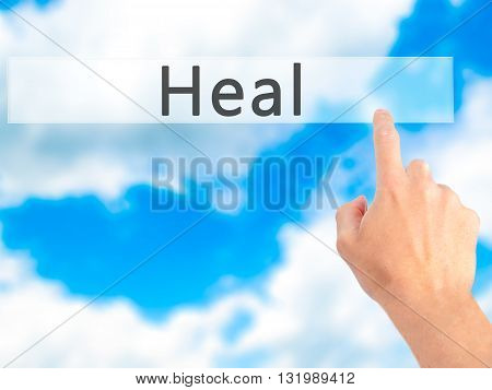 Heal - Hand Pressing A Button On Blurred Background Concept On Visual Screen.
