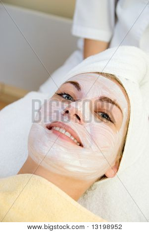 Beautiful young woman in spa salon