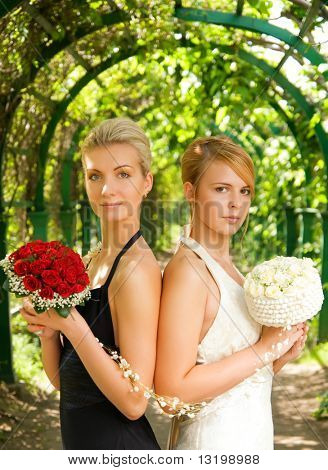 Two girls with a flowers in green alley