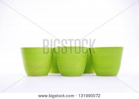 green decorative flower pots on white background
