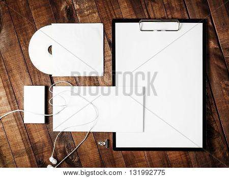 Blank stationery set on vintage wooden table background. Blank corporate identity template. Mock-up for branding identity. Top view.