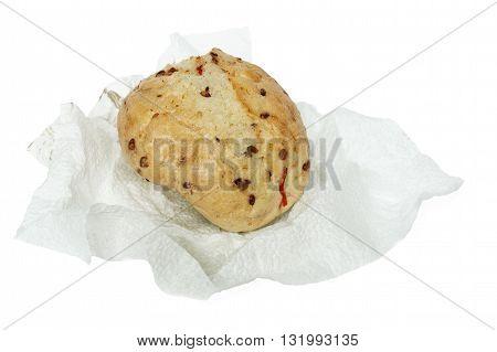 Bun wheat on a paper napkin isolated on white