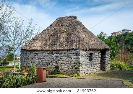 Reconstruction of old traditional stone house of Madeira. Historical and culture park at Santana. Madeira island, Portugal.