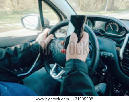 Abstract Blur Driving On Road, View Of Driver Messaging In Car